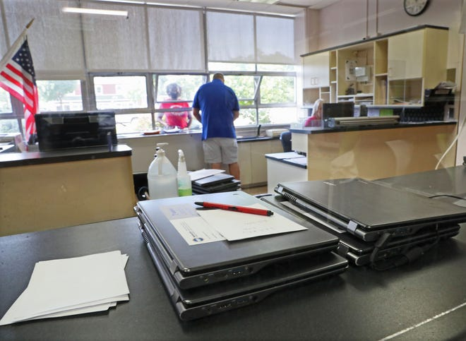 Chromebooks await students at Milwaukee School of Languages on the first day of school Monday at the MPS school that is on the early-start calendar.