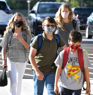 Most Green Hill High students arrived with masks in place Monday, Aug. 17, 2020, for Wilson County Schools' first day of classes amid COVID-19 and after the March tornado in Mt. Juliet, Tenn. The school will transition to all-remote learning Nov. 17, 2020, because of a spike in COVID-19 cases.