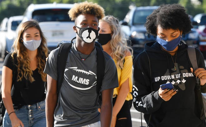 Most Green Hill High students arrived with masks in place for Wilson County Schools' first day of classes Monday, Aug. 17, 2020, amid COVID-19 and after a tornado in Mt. Juliet, Tenn.