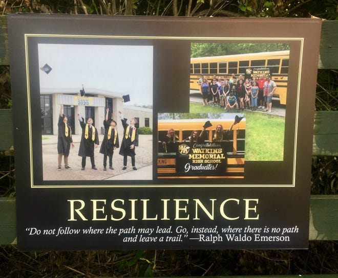 """One of the several new panels lining the Municipal Park """"Story Trail,"""" this one celebrating Watkins Memorial High School graduates and """"resilience,"""" with a quote from poet Ralph Waldo Emerson."""