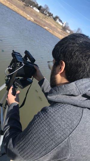 Granville High School alum Rodrigo Mayet-Valasco filming at the Granville Intermediate School Land Lab.