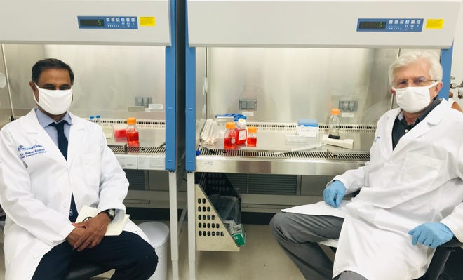 Dr. Rene Anand, (left), CEO and founder of Neurxstem, and Dr. Alex Kouriatov, senior research scientist, in the clean room lab of the Horton Building on the Central Ohio Aerospace and Technology Center campus in Heath.