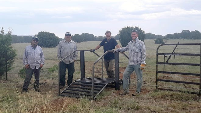 From left are: Alex Torres, Brian Martinez, Rob Bauer, Chad Martin. These men were instrumental in placing the roll-over cattle guard for mountain bikers.
