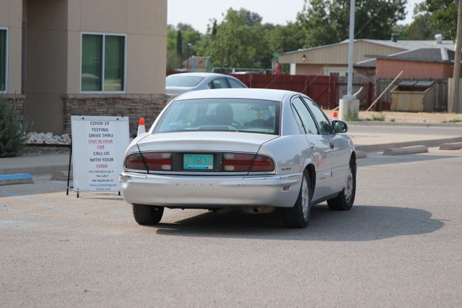 A car waits for COVID-19 testing on Aug. 17, 2020 at the Eddy County Public Health Office in Artesia. Eddy County's fifth COVID-19 death was reported Saturday by the New Mexico Department of Health.