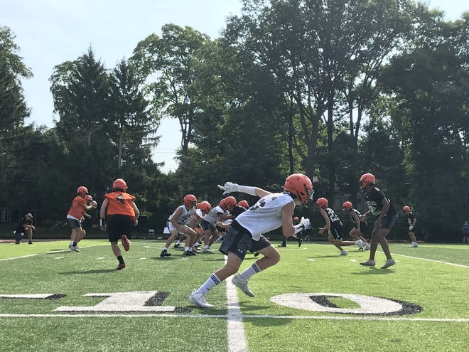 Brother Rice football runs a drill during its Friday practice, the last one before the MHSAA moved the season to spring 2021.