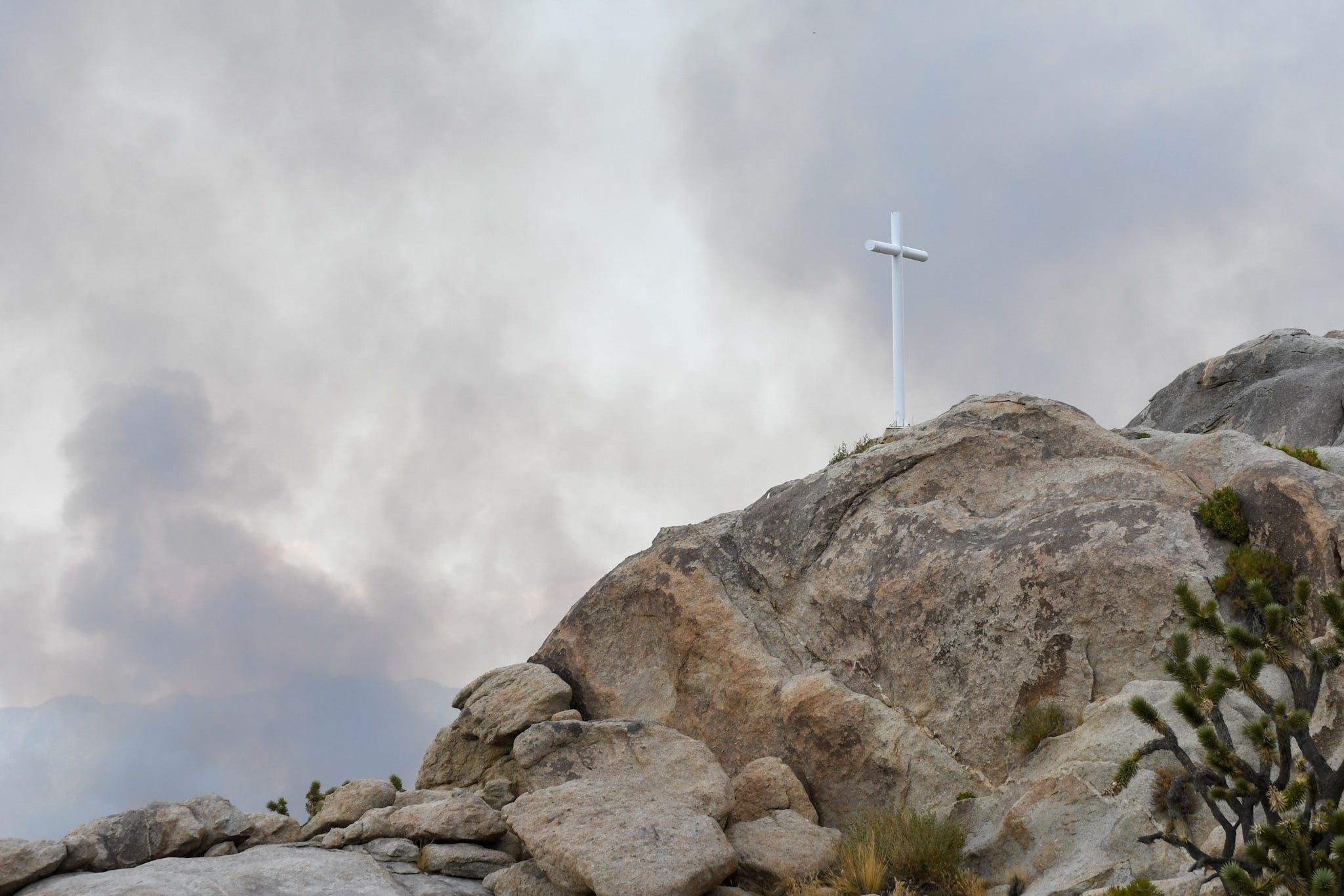 Smoke from the Dome Fire rises around the Mojave Cross in the national preserve on Aug. 17, 2020.