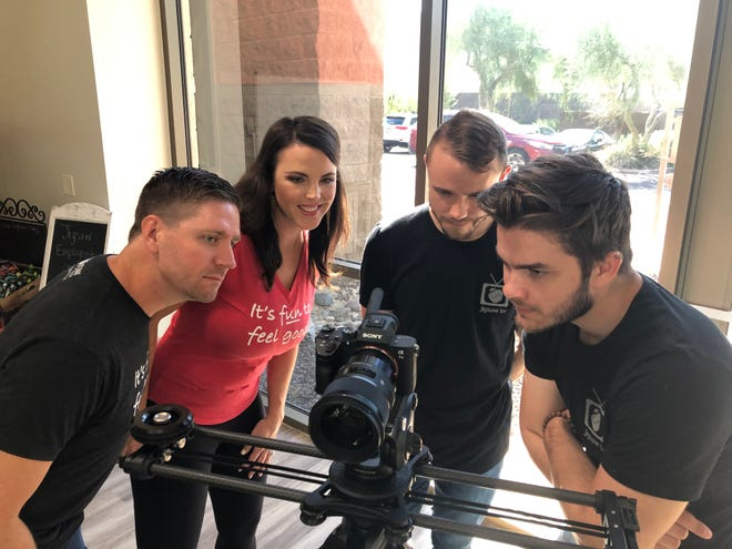 Jigsaw Health CEO Patrick Sullivan Jr. (left to right), business development manager Ashley Leroux, director of video production Cory Malkin and graphic designer Christian Kalos review the footage from a recent filming of one of the company's popular Funny Friday videos.