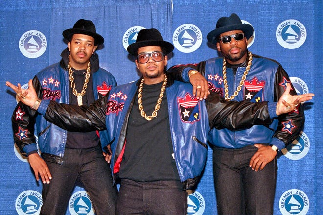 """FILE - The rap group Run-DMC, from left, Joseph """"Run"""" Simmons, Darryl """"DMC"""" McDaniels, and Jason Mizell """"Jam Master Jay,"""" poses at the 31st annual Grammy Awards in New York, on March 2, 1988.  Two suspects have been indicted in the 2002 killing of hip hop artist Jam Master Jay, which until now had been one of New York City's most notorious unsolved killings, according to two law enforcement officials, Monday, Oct. 17, 2020. (AP Photo/Mark Lennihan, File)"""