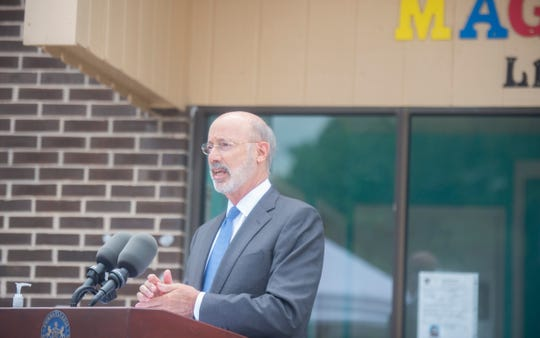 Gov. Tom Wolf speaks to members of the media outside Magical Days Learning Center in West Manchester Township during a press conference on Small Business Assistance Grant program and COVID relief funding on Monday, August 17. Magical Days received $25,000 in state grant funding through program. In total the state allocated $96 million to nearly 5,000 businesses throughout the commonwealth.