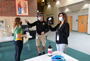 Bishop Manogue students temperatures are scanned and students sanitize as they enter on the first day back to school amid the COVID Pandemic on Monday August 17, 2020