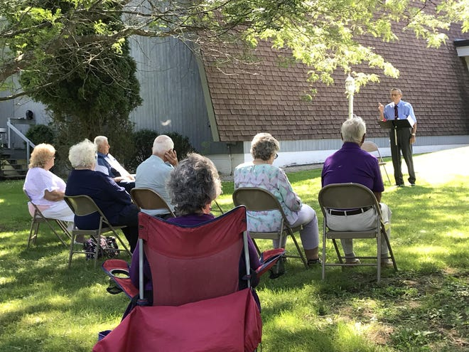 Pastor John Karle gives his message to the Faith Bible Church congregation gathered on the front lawn of the Honeoye church on Sunday, Aug. 9, 2020.
