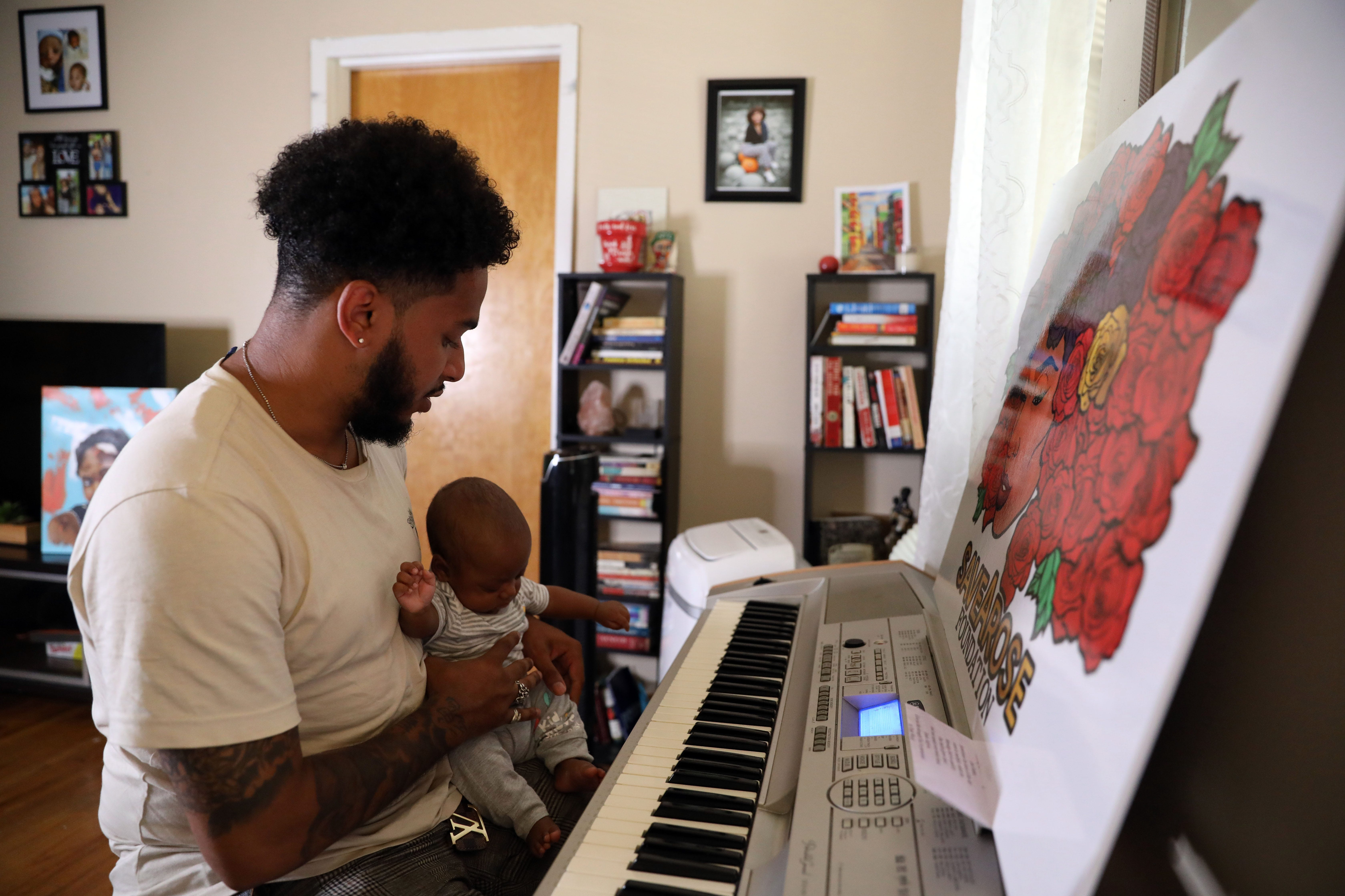 """Bruce McIntyre plays music for his son, Elias McIntyre, just like he did when he was in the womb. Bruce and his partner, Amber Isaac, did not know she had low blood platelets until a midwife checked her lab results when screening her health for a home birth. """"Amber had maybe four or five doctors signing off on her paperwork — they didn't tell us at all that her platelet levels were dropping at a dangerous rate, so obviously they weren't paying attention,""""McIntyre said. """"They were just signing off."""" Isaac died giving birth to their son through a C-section."""