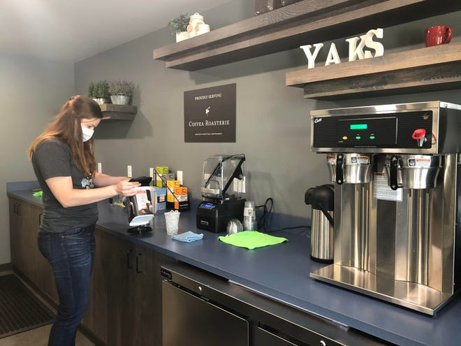 Meredith Molseed, store manager at Yakkity Yak Coffee Shack, prepares a frappuccino at the coffee shop Sunday afternoon. The business opened to the public Monday after the coronavirus pandemic delayed its opening.