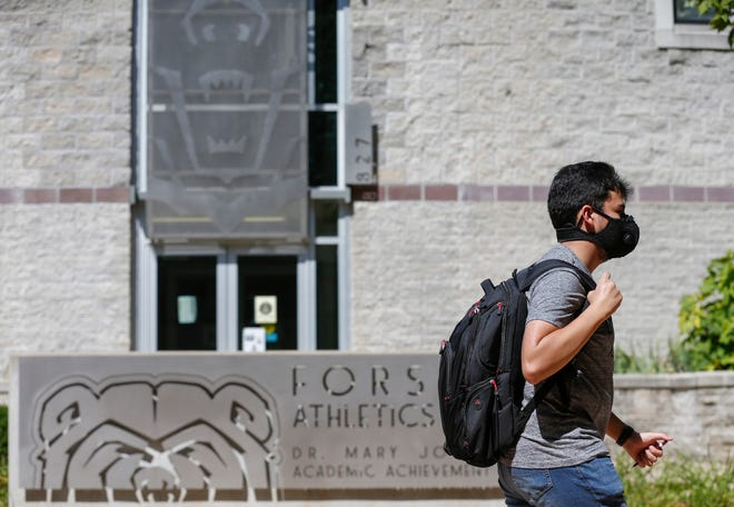 A student walks on campus during the first day of classes Aug. 17 at Missouri State University. Face masks were just one of the many safety precautions implemented.