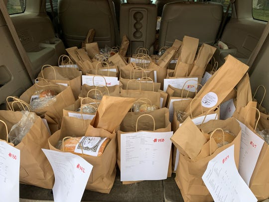 Bags of orders from Wild Flour Bakery wait for delivery in Delaware. The bakery makes deliveries in New Castle County on Wednesdays.
