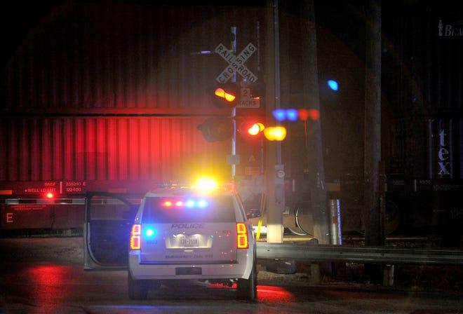 Wichita Falls police work the scene of a fatality involving a train Saturday night on North Beverly at Iowa Park Road.