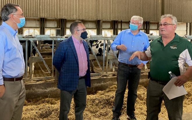 Touring Deer Run Dairy, from left, EPA Region 5 Administrator Kurt Theide, EPA Administrator Andrew Wheeler, Representative Glenn Grothman and farm owner Duane Ducat. Officials stopped to talk about how cows are kept cool and comfortable in the summer heat.