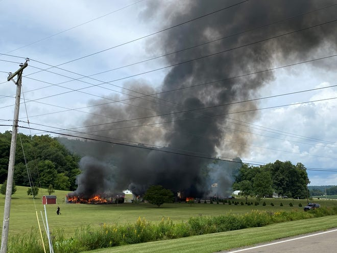 Black smoke rises from a fire on Black Run Road.