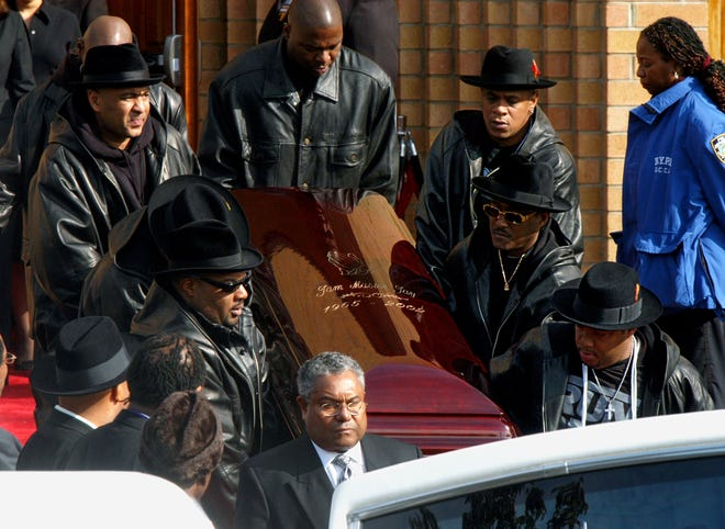 """Jason """"Jam Master Jay"""" Mizell's coffin is carried out after his funeral on Nov. 5, 2002."""
