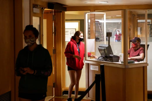 A student swipes into Earhart Dining Hall, Thursday, Aug. 13, 2020 at Purdue University in West Lafayette, Ind.