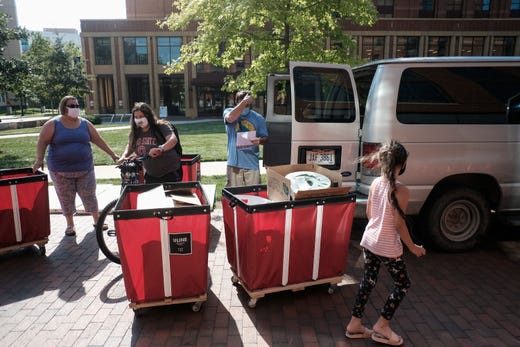 Incoming students began moving in on the OSU campus on Aug. 13, 2020 in Columbus, Ohio. All students moving into the dormitories are required to schedule a time to move in gradually with only 8 students permitted to move into a building in the same hour as an attempt to prevent spread of the coronavirus (COVID-19) among OSU students.