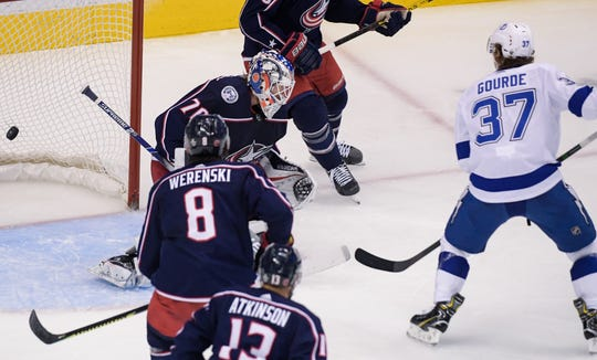Tampa Bay Lightning center Yanni Gourde scores a goal against Columbus Blue Jackets goaltender Joonas Korpisalo.