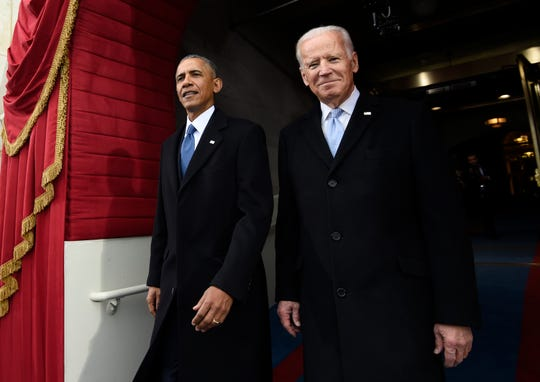 In this Jan. 20, 2017, file photo, President Barack Obama and Vice President Joe Biden arrive for the Presidential Inauguration of Donald Trump at the U.S. Capitol in Washington. Biden is releasing a video of his first in-person meeting with former President Obama since the coronavirus outbreak began, enlisting the former president to help slam his successor's response to the pandemic.