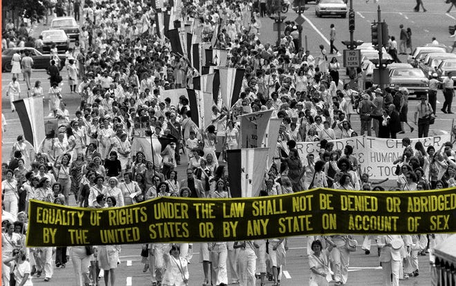 Supporters of the Equal Rights Amendment carry a banner down Pennsylvania Avenue in Washington, D.C., in 1977.