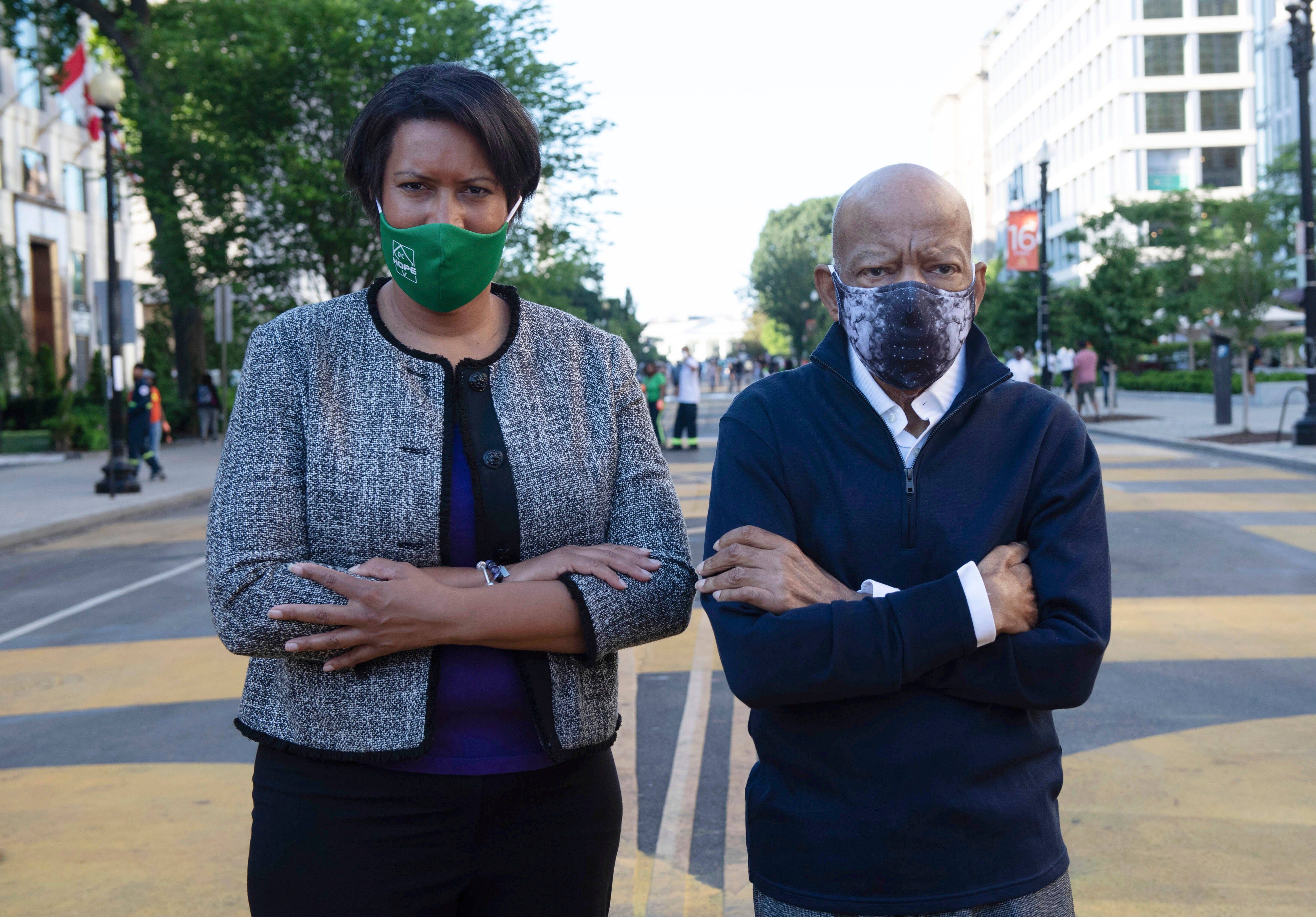 Washington Mayor Muriel Bowser stands with civil rights icon John Lewis on June 7, 2020, on a section of 16th Street renamed Black Lives Matter Plaza. The White House is in the background.