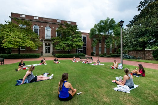 College students eat dinner outside at the University of South Carolina on Aug. 10, 2020 in Columbia, S.C.