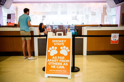 A sign at the front desk of Fred Brown Hall reminds residents to keep social distancing at the University of Tennessee in Knoxville on Aug. 14, 2020.