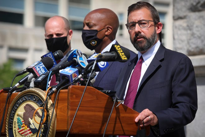 Acting U.S. Attorney Seth DuCharme, right, N.Y. Chief of Detectives Rodney Harrison, center, and ATFE Acting Special Agent-in-Charge Daryl McCormick, left, announce charges against two individuals in the almost 18-year-old murder case of rap pioneer Jam Master Jay of Run-DMC.