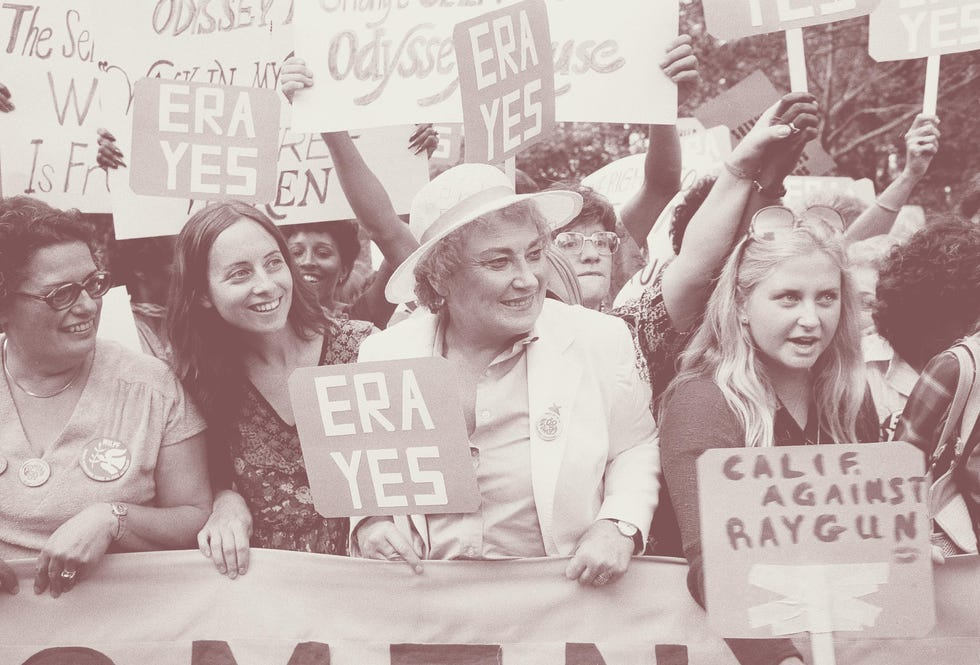 Bella Abzug, center with hat, smiles as she holds up her ERA sign in a pro-equal rights demonstration on New York's Fifth Avenue, Aug. 26, 1980. About 5,000 marchers marched down Fifth Avenue chanting pro-equal rights slogans to celebrate the 60th anniversary of women receiving the right to vote.
