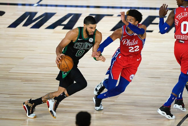 The Celtics' Jayson Tatrum tries to get past Sixers rookie Matisse Thybulle during Game 1 on Monday night. [Ashley Landis/AP Photo]