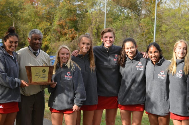 Moorestown Friends senior captain Renna Mohsen-Breen, NJSIAA executive director Larry White, senior captain Elena Syliades, sophomore Bella Pescatore, junior Lisa Seiler, sophomore Skye Mada, Roma Jha and junior Natalie Julian pose with the 2019 Nonpublic B championship trophy.
