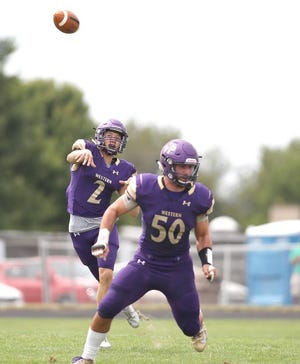 Western Beaver quarterback Thaddeus Gray (2) gets a pass off while being protected by Zach Altenbaugh (50) during the first half against South Side last season.