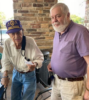 Commander Charles Spense of American Legion Post 27 presents Jack Daniels with his renewal membership card.According to Commander Spense; Daniels, age 94 is one of the oldest most active veterans in the parish.