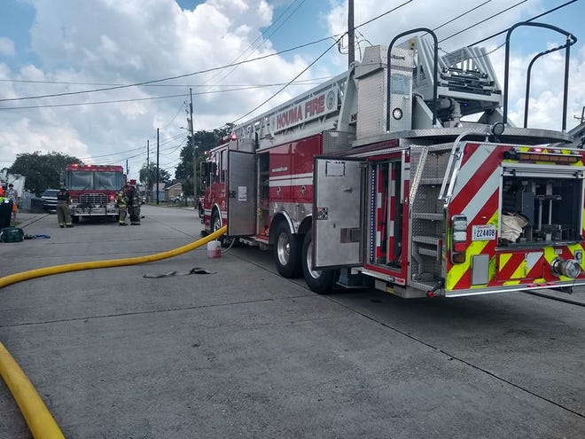 Fire crews arrive to battle a blaze this morning in Houma.