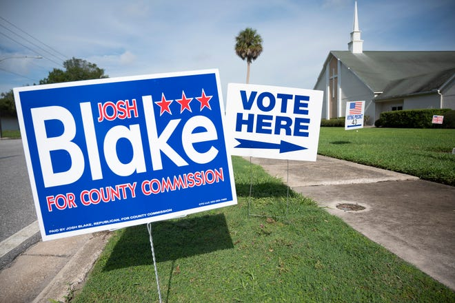 Signs line the entrance to a voting precinct in Eustis. [Cindy Peterson/Correspondent]