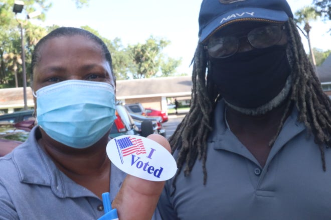 """Sherry Chiress and her husband, Clinton, of Daytona Beach, proudly display their """"I voted"""" sticker outside the Beville Road Church of God on Tuesday. """"I always enjoy coming and voting myself,"""" Sherry said."""