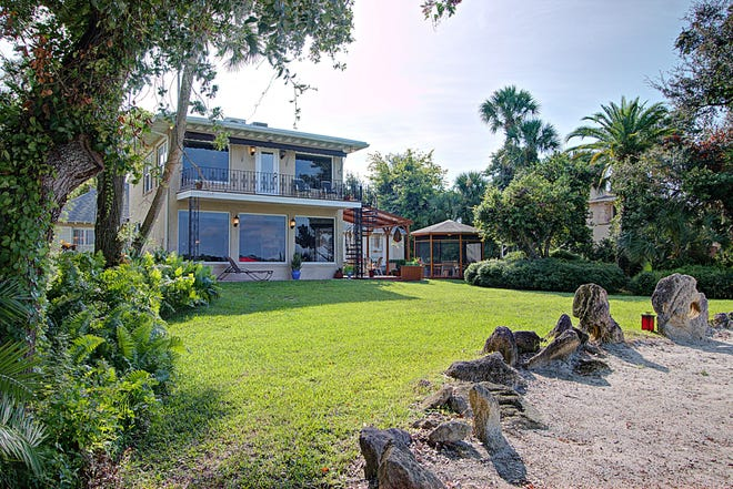 This mid-century Ormond Beach estate on one of the largest lots on the Intracoastal Waterway is set back from Riverside Drive on a manicured lawn to give the owners all the privacy needed to enjoy a peaceful life.