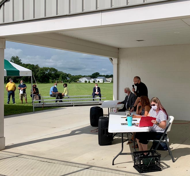 A scene from the Aug. 6 foreclosure sale at the Kent County Recreation Center's outside pavilion.