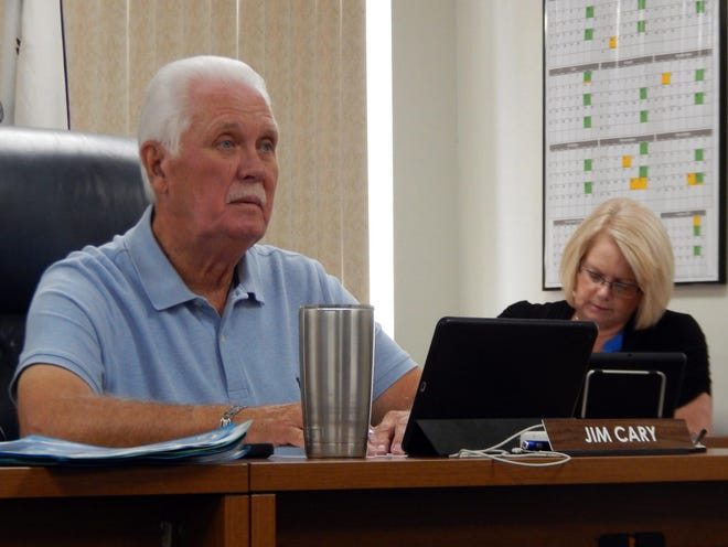 Des Moines County Supervisor Jim Cary listens as Public Health Director Christa Pogemiller updates the Board and other county department heads on COVID-19 as Des Moines County Auditor Terri Johnson keeps notes Tuesday during the superviswors meeting at the Des Moines County Courthouse.