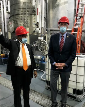 Dr. Anil Oroskar shows Congressman Darin LaHood specifics on the sanitizer production line Tuesday at the plant in Glava, Illinois.