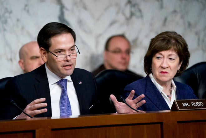 In this March 21, 2018, file photo, Sen. Marco Rubio, R-Fla., left, accompanied by Sen. Susan Collins, R-Maine, right, speaks before a Senate Intelligence Committee hearing on election security on Capitol Hill in Washington. The Senate intelligence committee has concluded that the Kremlin launched an aggressive effort to interfere in the 2016 presidential contest on behalf of Donald Trump. The Republican-led panel on Tuesday released its fifth and final report in its investigation into election interference. (AP Photo/Andrew Harnik)