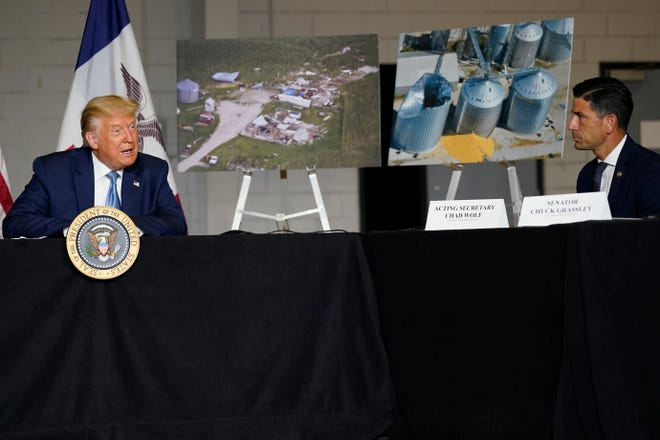 Department of Homeland Security Acting Secretary Chad Wolf, right, listens as President Donald Trump speaks during a briefing on derecho damage and recovery efforts in Iowa on Tuesday in Cedar Rapids, Iowa.