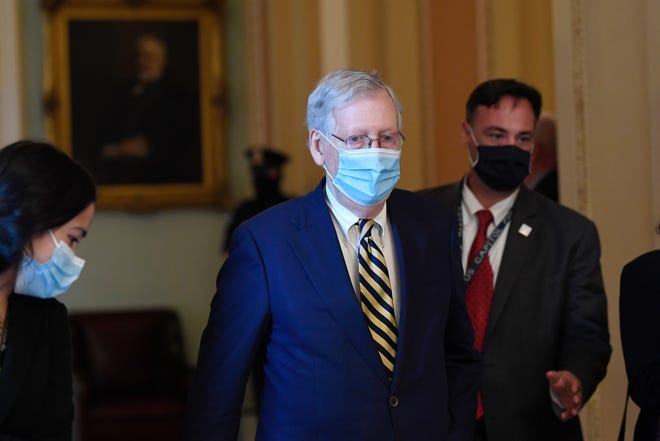 Senate Majority Leader Mitch McConnell, R-Ky., walks back to his office on Capitol Hill in Washington earlier this month.
