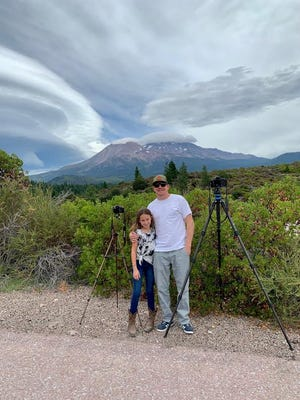 Photographers Ryan and Ava Workman prepare to take photos of Mt. Shasta and a lenticular cloud on Aug. 16, 2020.
