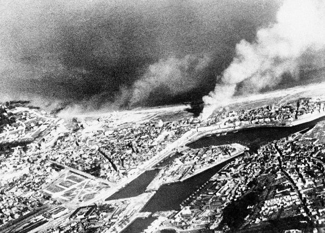 Smoke from the battle and a big fire on the waterfront drift over Dieppe at the height of the allied commando raid on the German-occupied French city on Aug. 19, 1942. [THE ASSOCIATED PRESS]