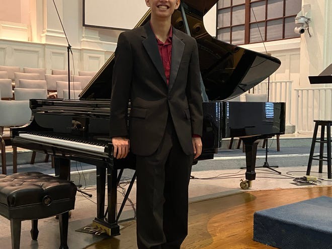 Pine View graduate Tri Nguyen at the piano.